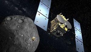Recreación digital de la sonda japonesa Hayabusa2 y el asteroide Ryugu cedida por la Agencia Aeroespacial de Japón (JAXA). La sonda nipona emprendió este miércoles su viaje de regreso a la Tierra tras conseguir muestras del remoto asteroide, lo que supone un logro sin precedentes en la exploración del universo.