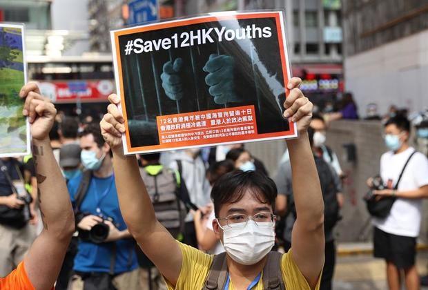Personas durante protesta contra la ley de seguridad que China.