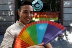 Un joven participa en la celebración del 'Día del orgullo LGTBI 2020' en Chueca, este domingo en Madrid.