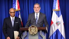El consultor jurídico del Poder Ejecutivo, Flavio Darío Espinal y Roberto Rodriguez Marchena , portavoz del Gobierno.