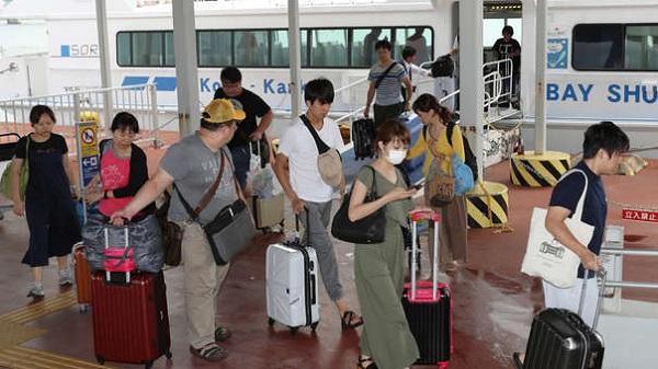 Taiwaneses tienen que declararse chinos para ser evacuados del tifón en Japón