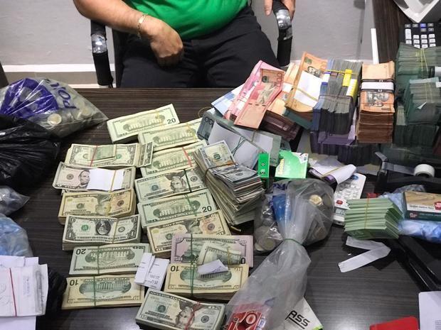 Incautan 5 millones de pesos y miles de dólares en una oficina de inversiones.