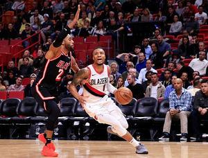 Blazers derrotan a Heat y amargan debut de Andre Iguodala.