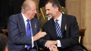 Felipe VI con su padre, el rey Juan Carlos.