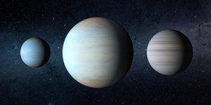 Versión artística del sistema planetario Kepler-47 con el gran planeta recién descubierto en medio.