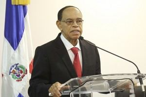 Presidente de la CNE, Lidio Cadet.