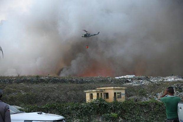 Leonel Fernández ofrece equipos para combatir incendio en el vertedero de Duquesa