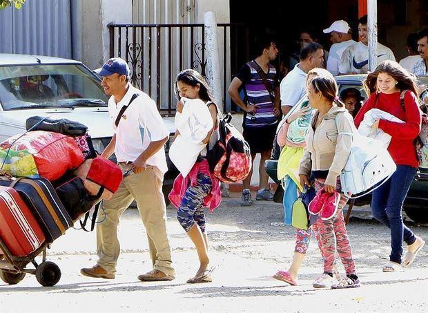 Número creciente de venezolanos espera asilo en la frontera de México y EEUU